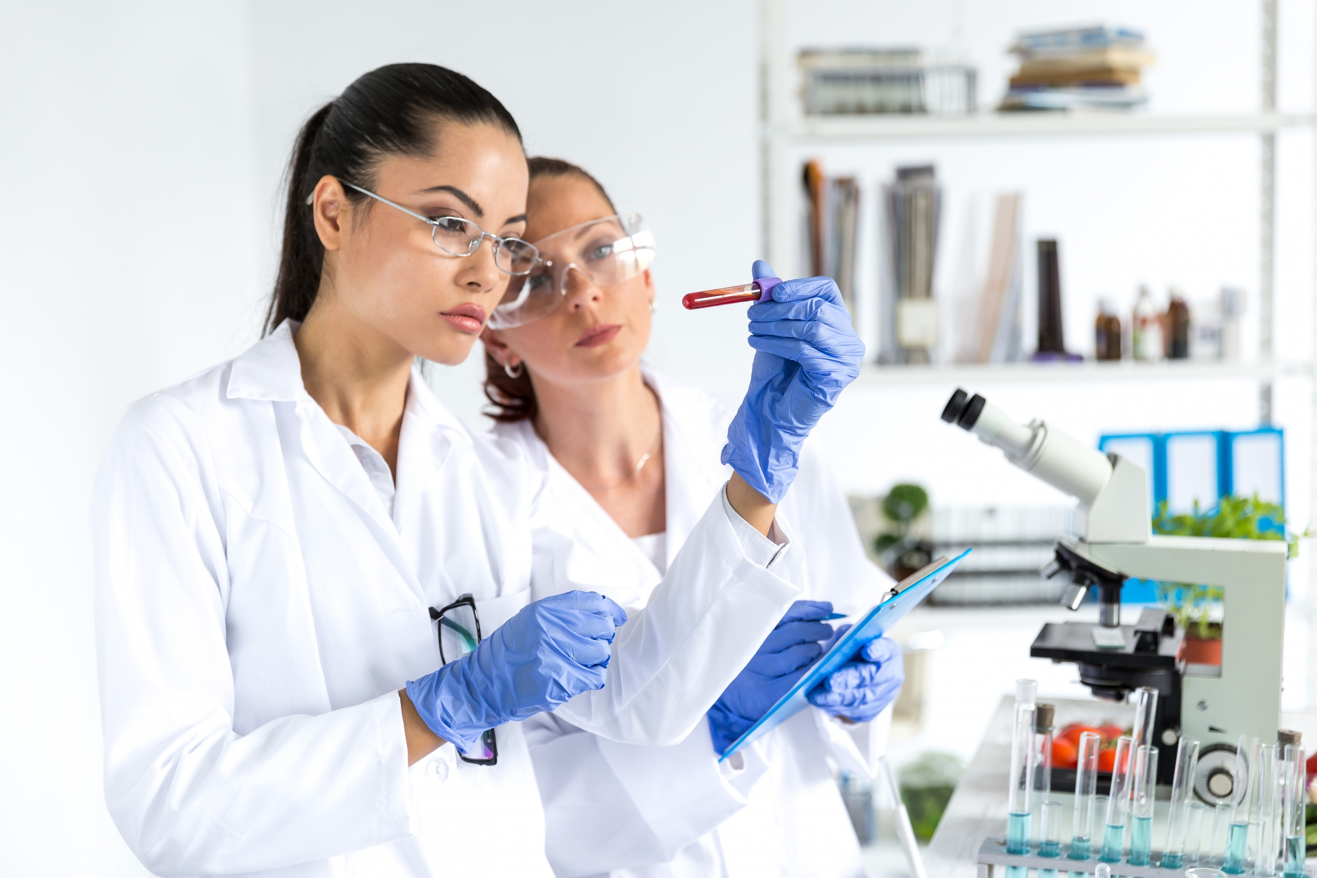 Two female laboratory technicians making blood tests.